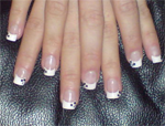 Two hands together with acrylic nailis